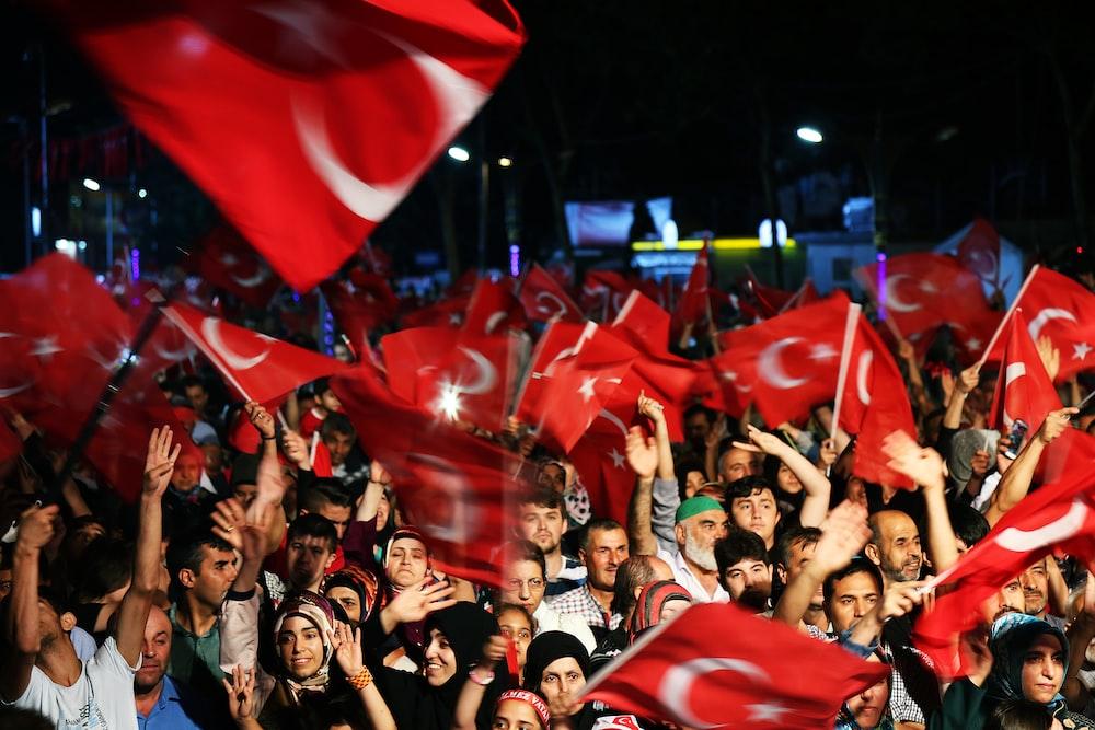 people waving flag of Turkey