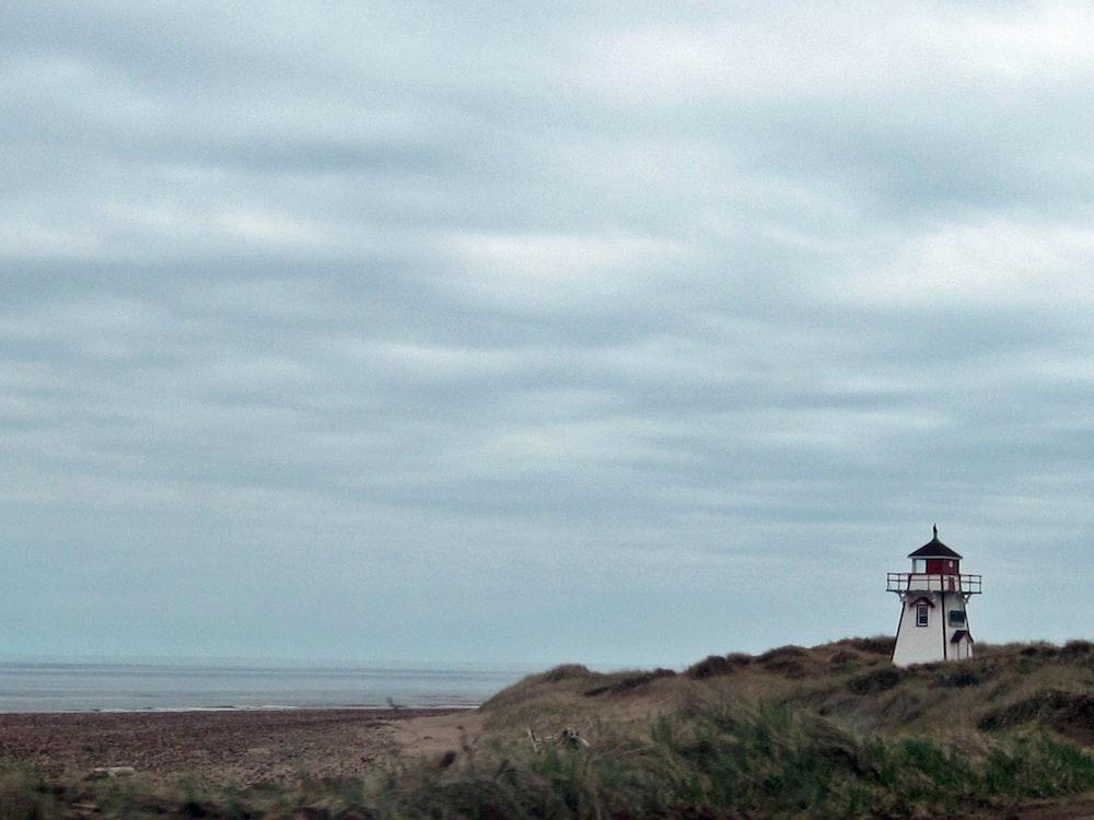 lighthouse near shore during daytime