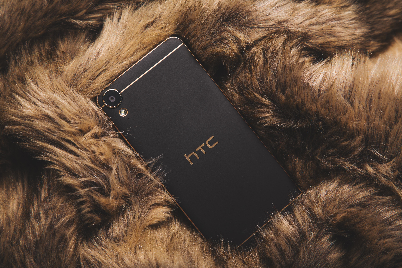 black HTC smartphone on fur textile
