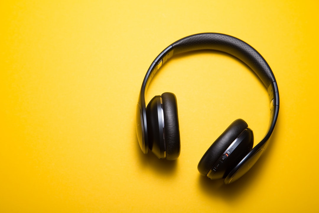 Black headphone on a yellow background