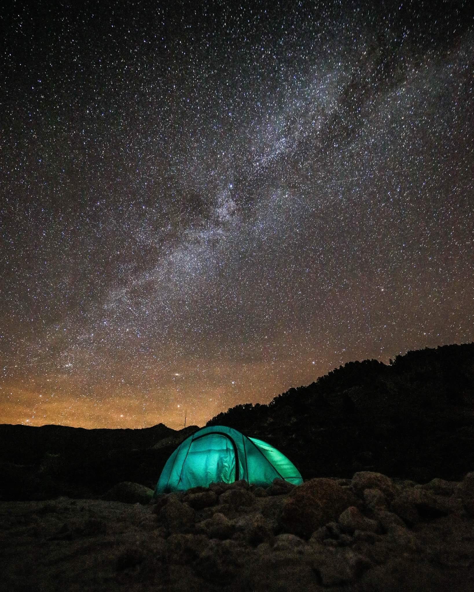 green tent under sky with stars