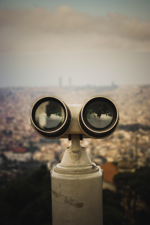 black and gray binoculars taken at daytime