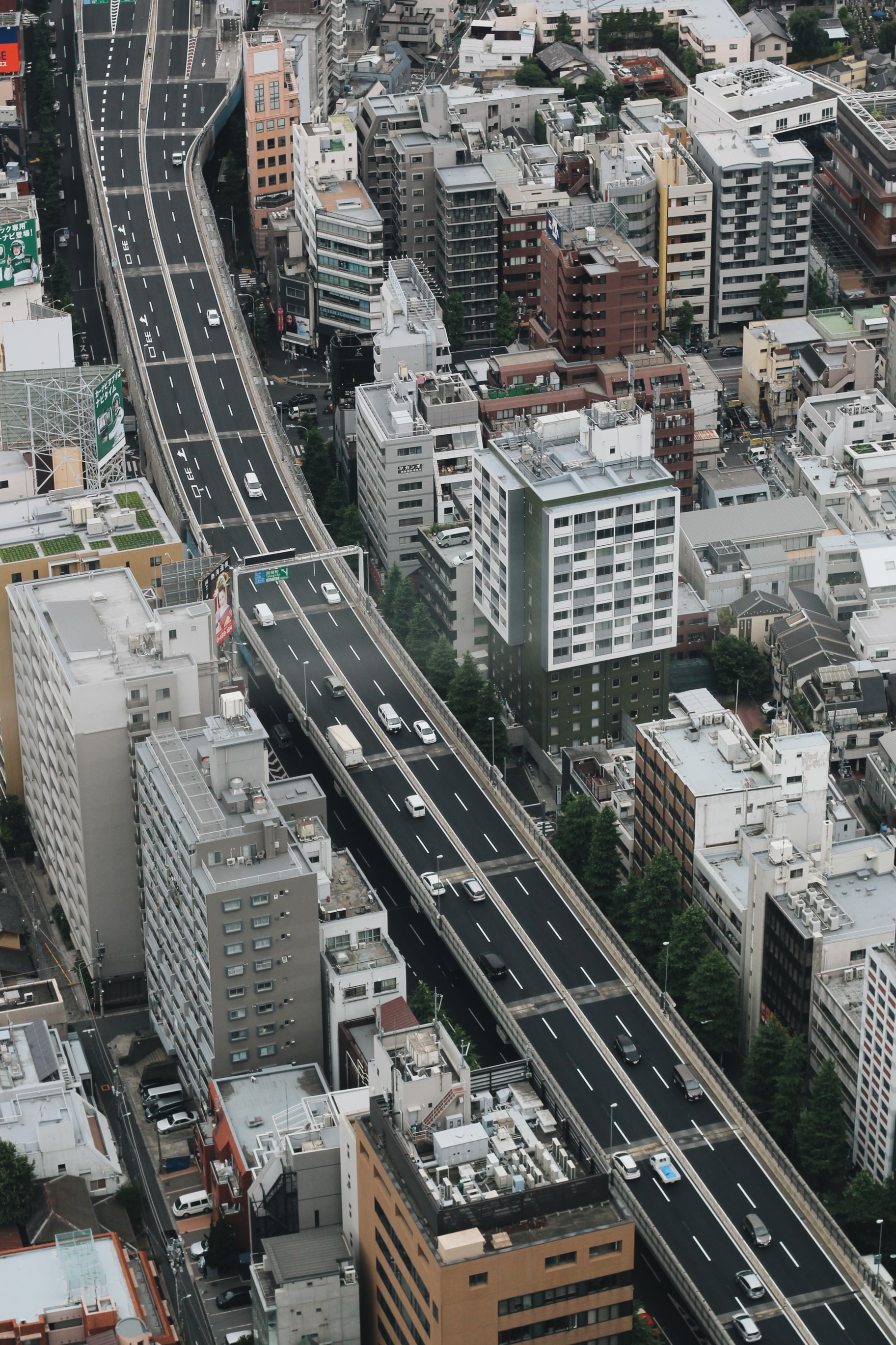aerial photo of black asphalted road with vehicles on top