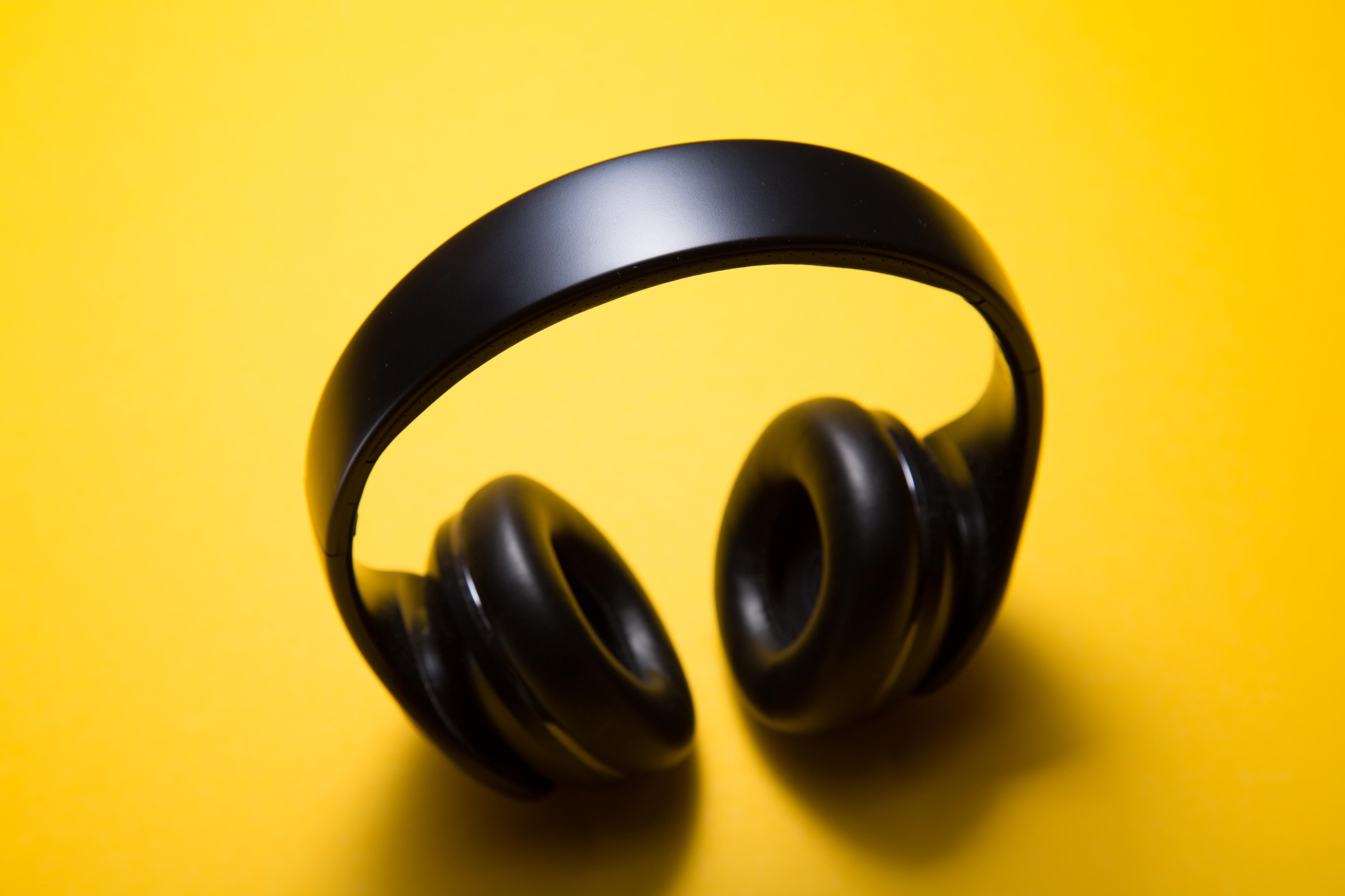 wireless headphones with yellow background