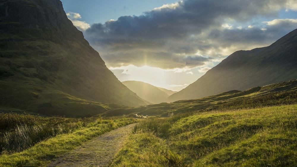landscape photography of mountain range facing sun rise