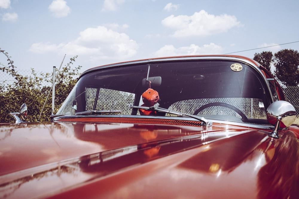 classic red car closeup photography