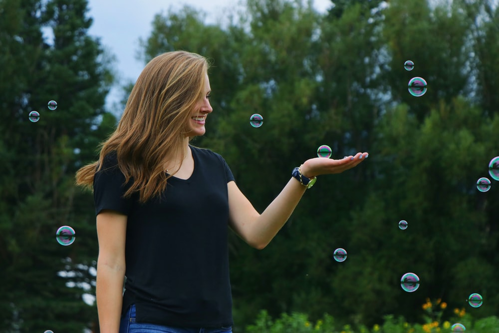woman standing in front of bubbles