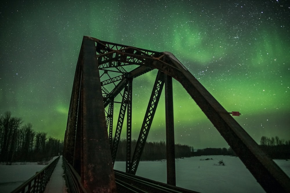 photo of bridge with Northern Lights