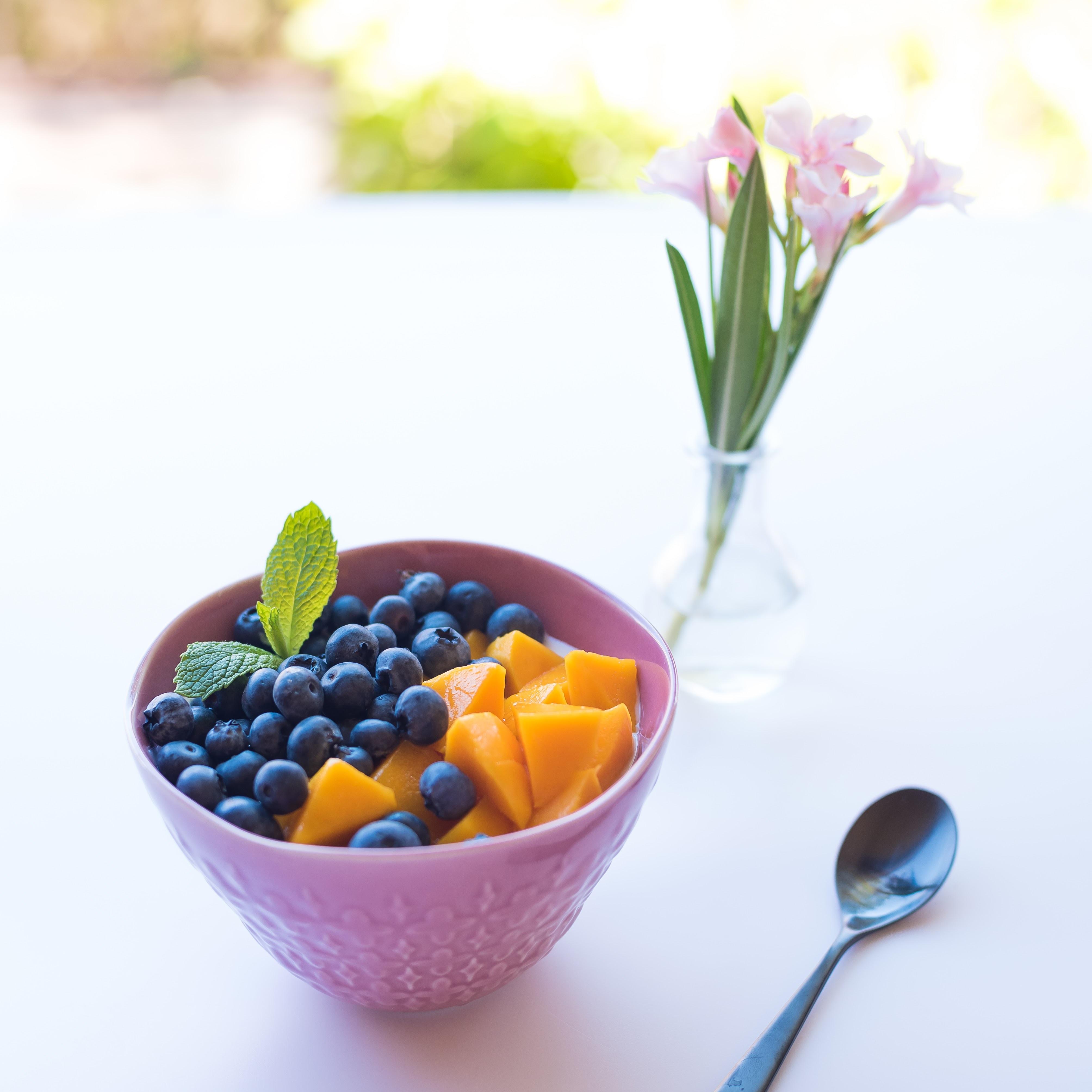 pink ceramic bowl besides spoon