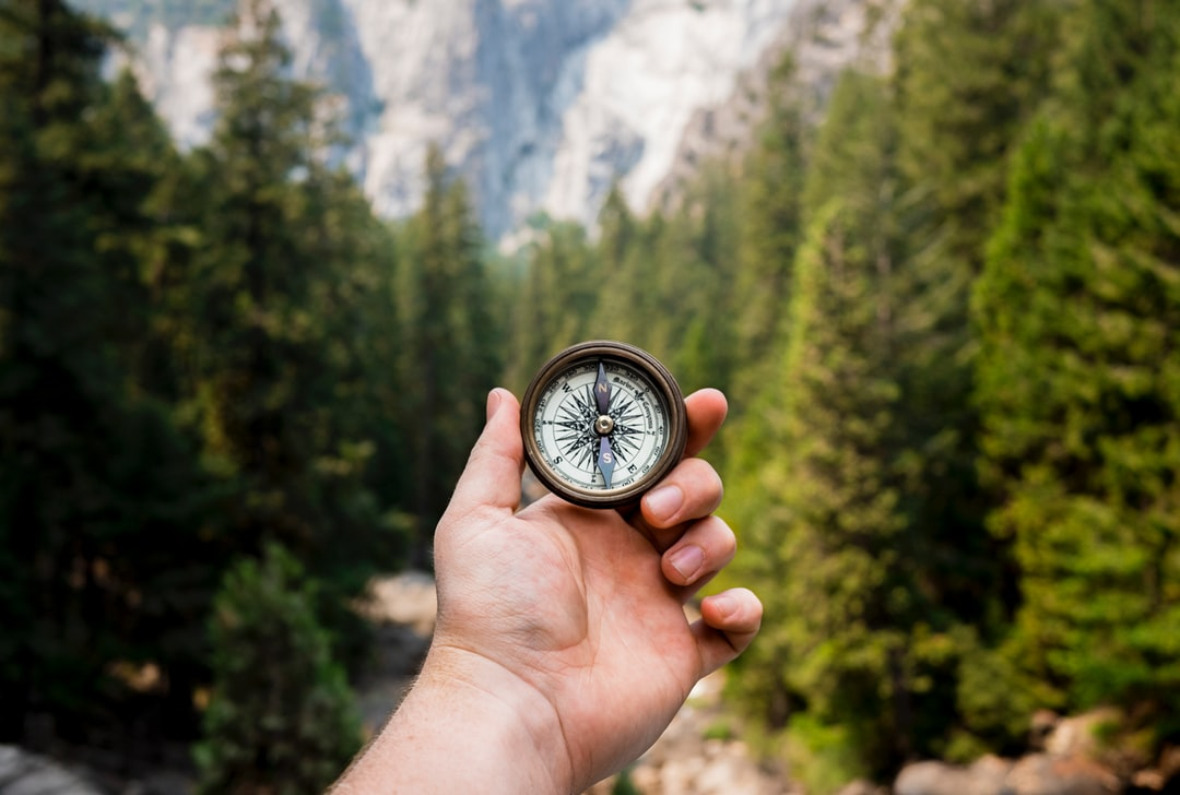 On my recent trip to California we decided to visit Yosemite National Park. After a 2 mile hike following a stream up a mountain I got this shot of a compass overlooking the valley below.