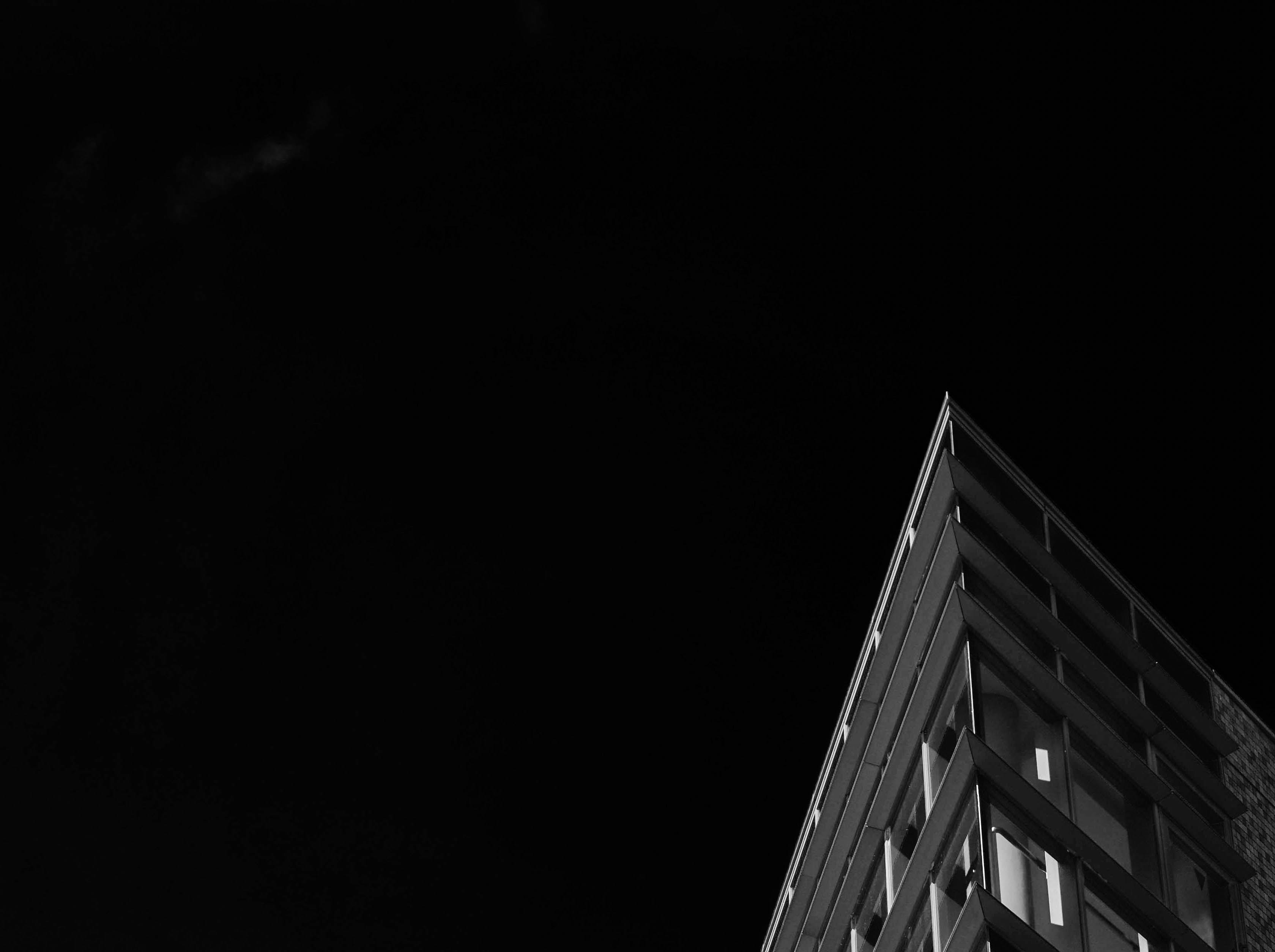 gray concrete building under night sky