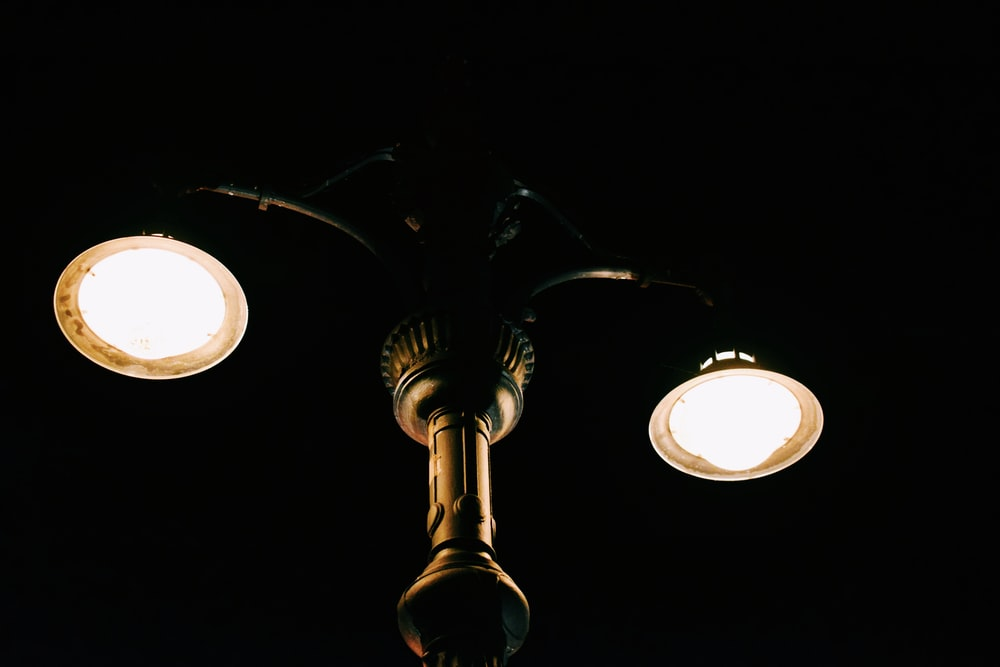 low angle photography of turned on lamp