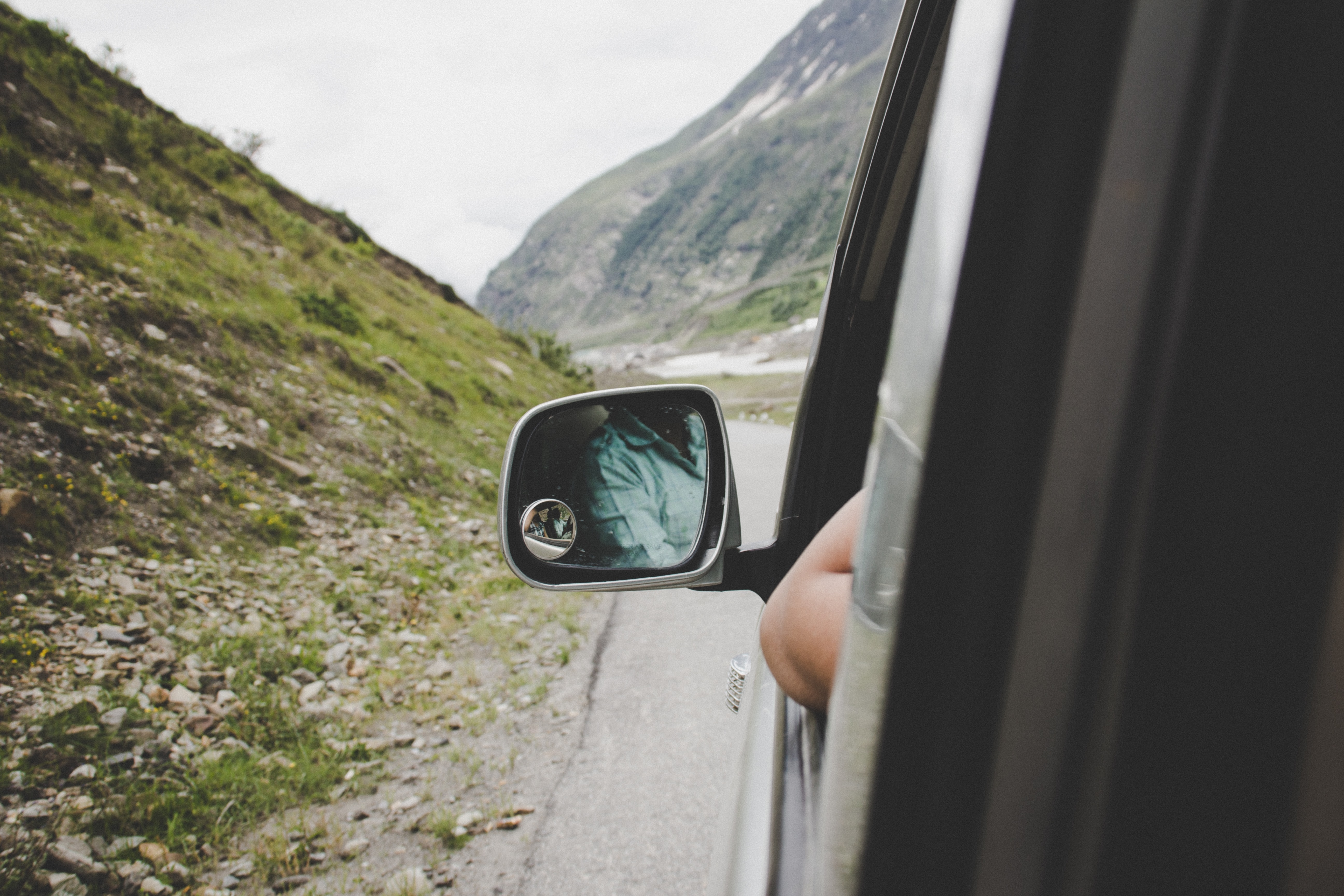 left side view mirror view at the back