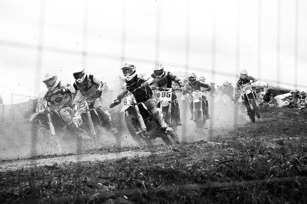 grayscale photo of dirt bike racing