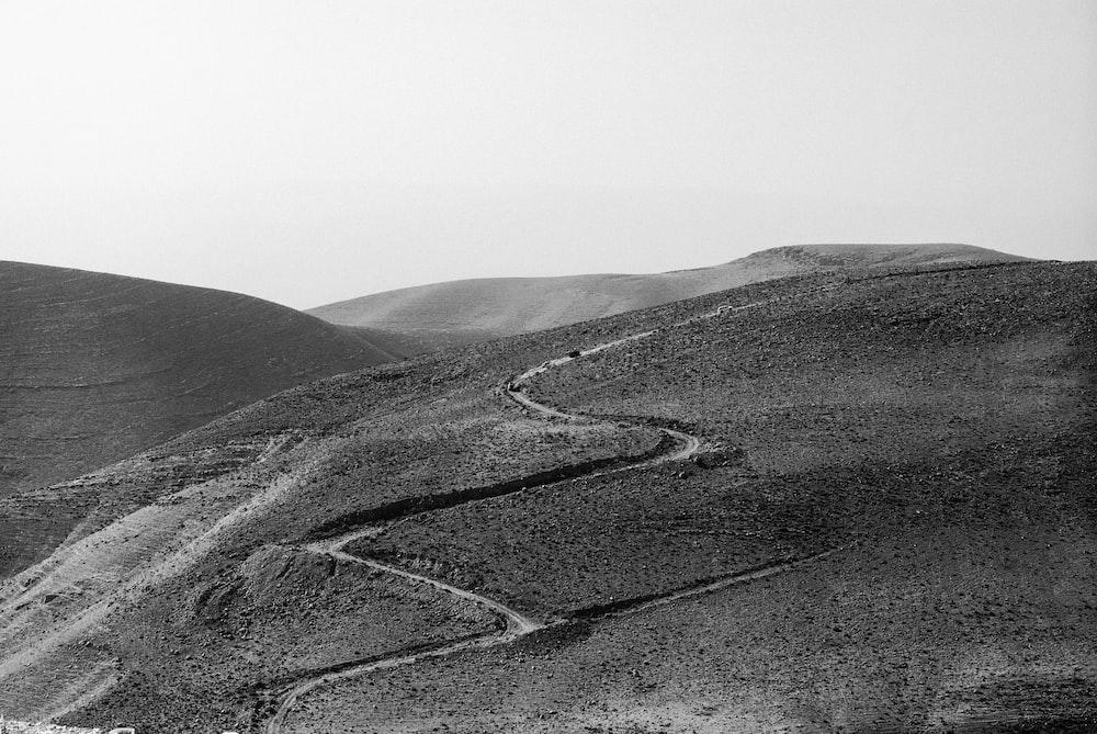grayscale photo of zig-zag road