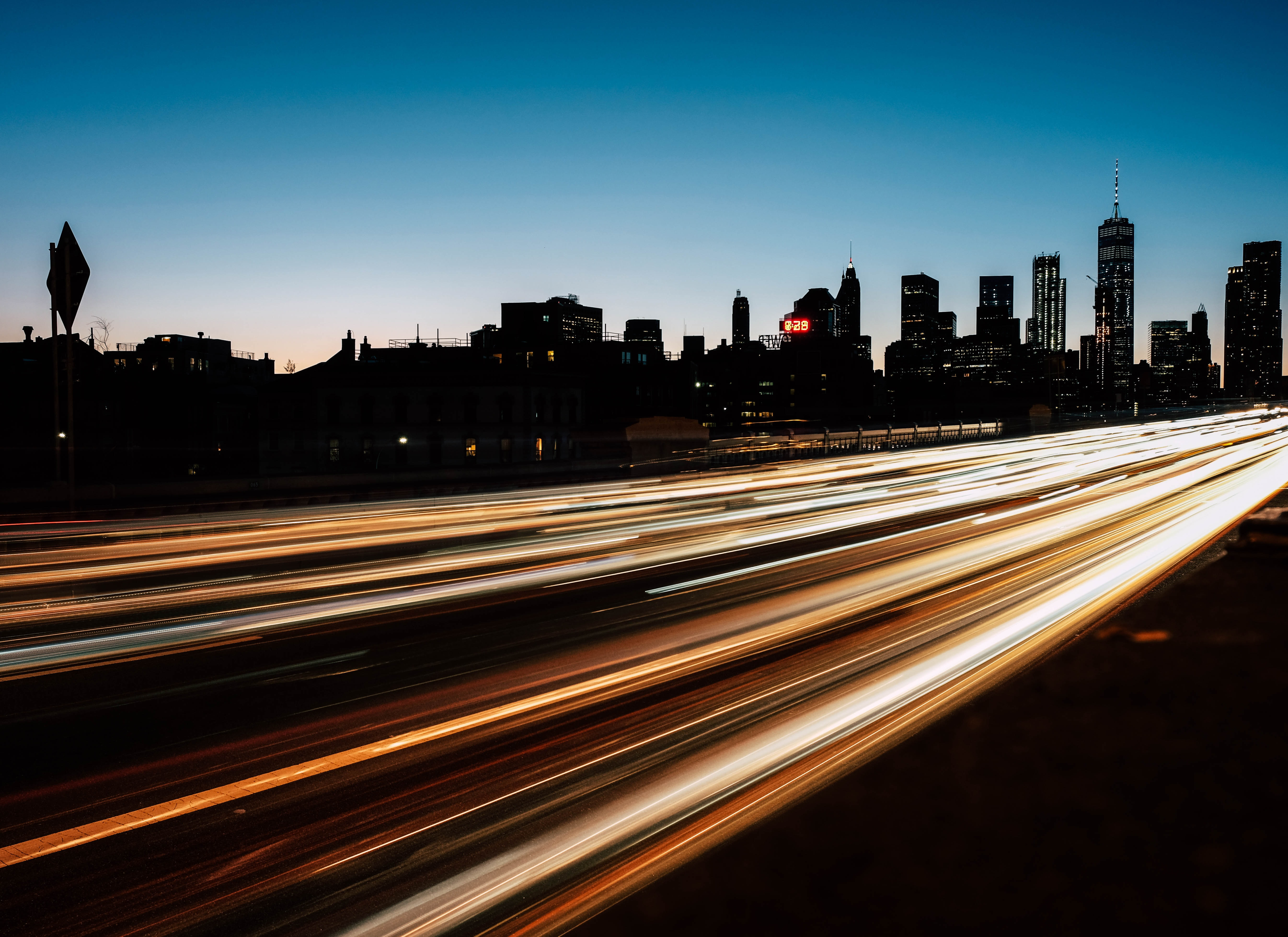 time lapse photography of passing vehicles on road
