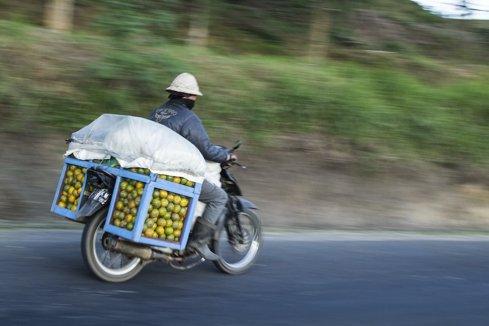 crated fruits on cascading motorcycle