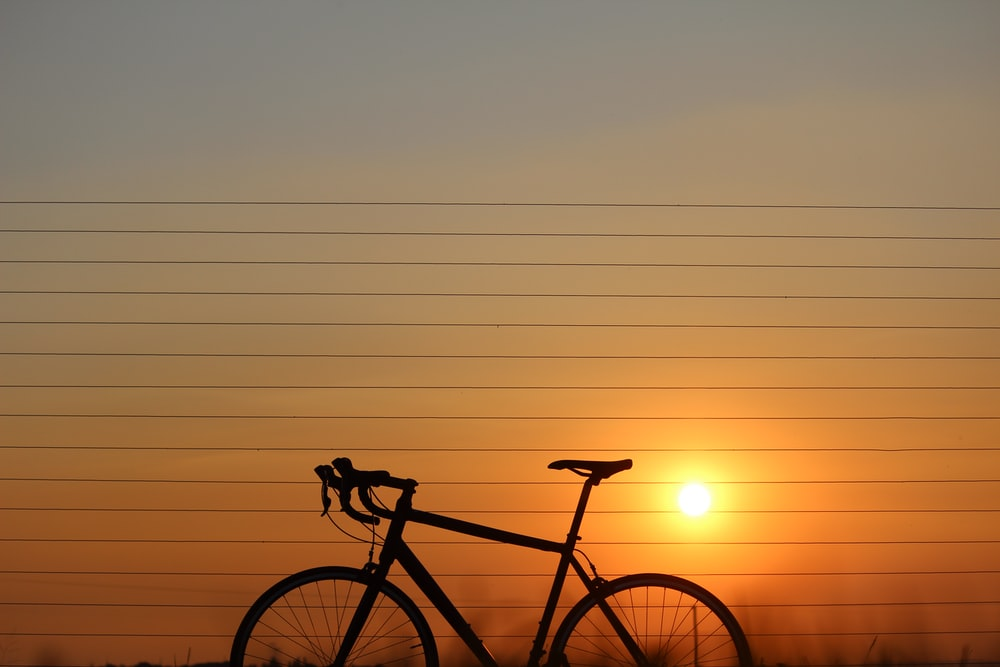 silhouette of road bicycle during sunset