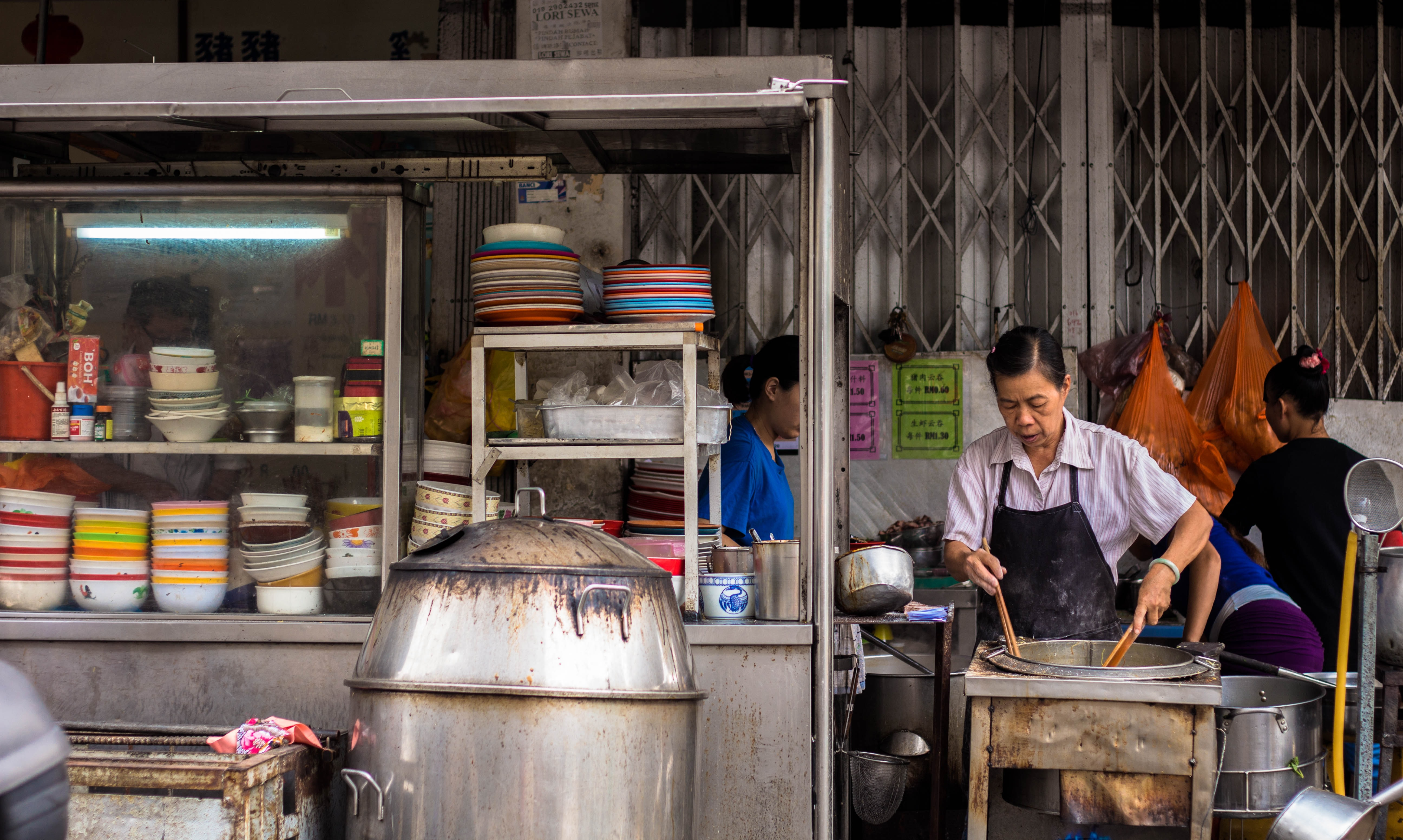 woman wearing black apron while cooking