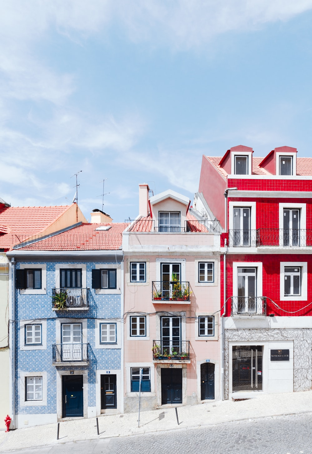 white and red concrete house
