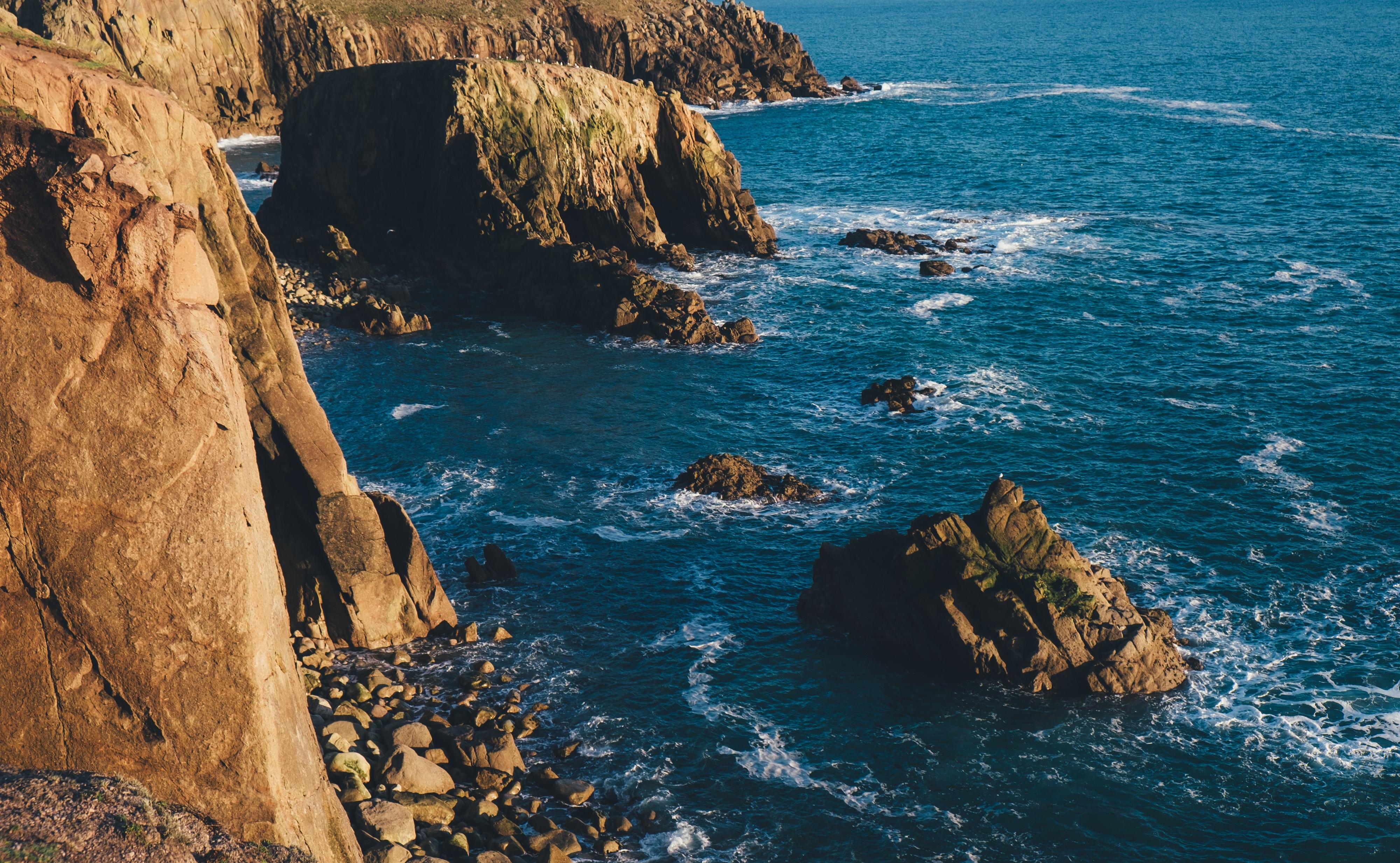 rock formation beside sea photo