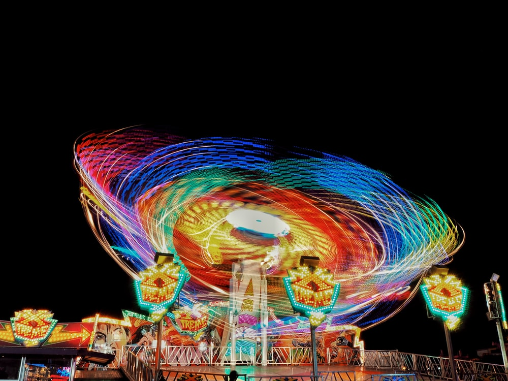 time-lapse photography of carnival ride during night
