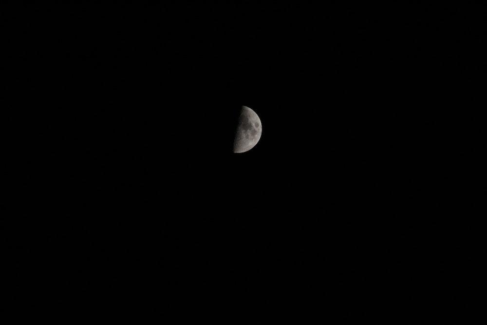 grayscale photography of half-moon