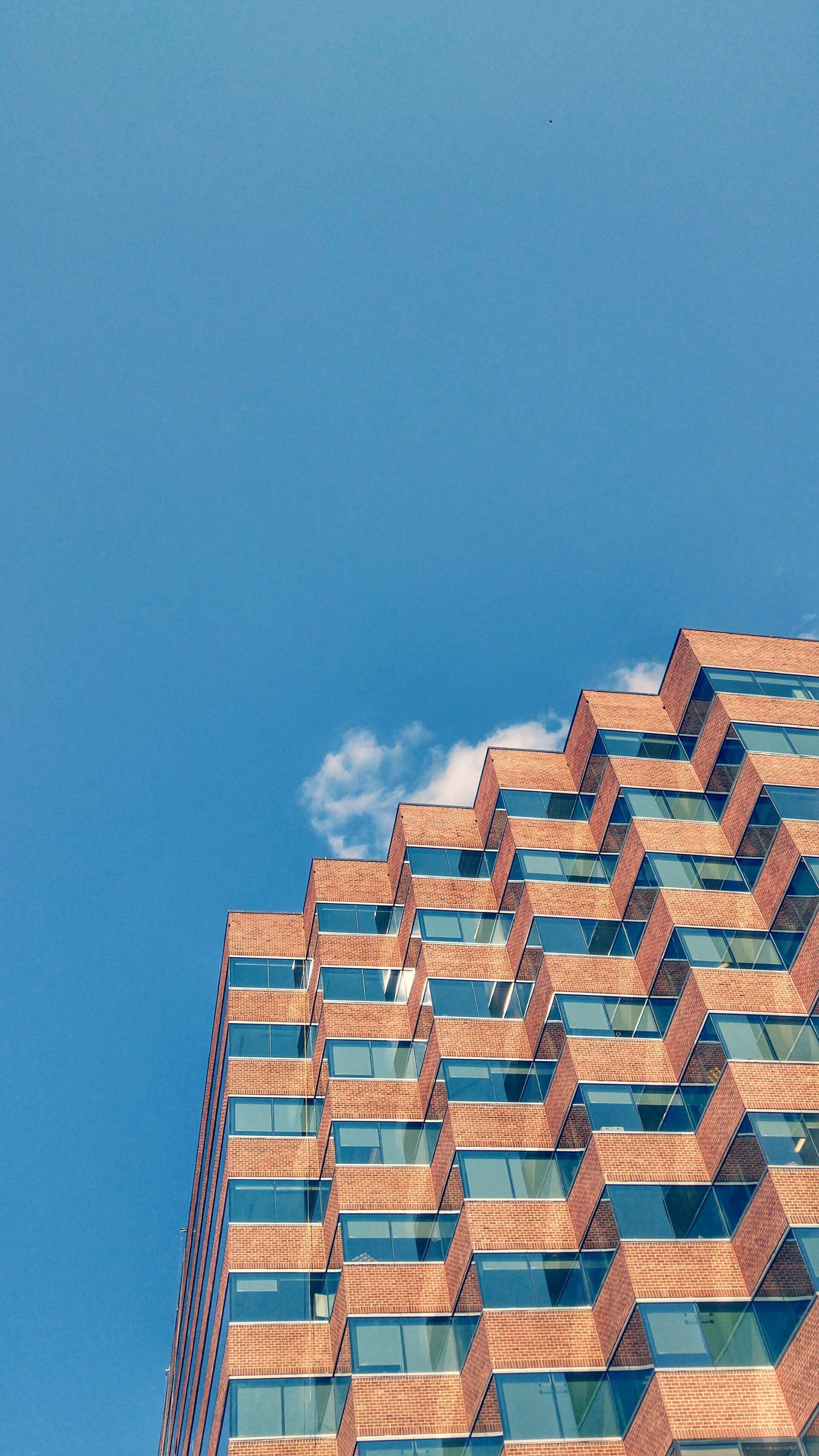 low angle photo of building under blue sky