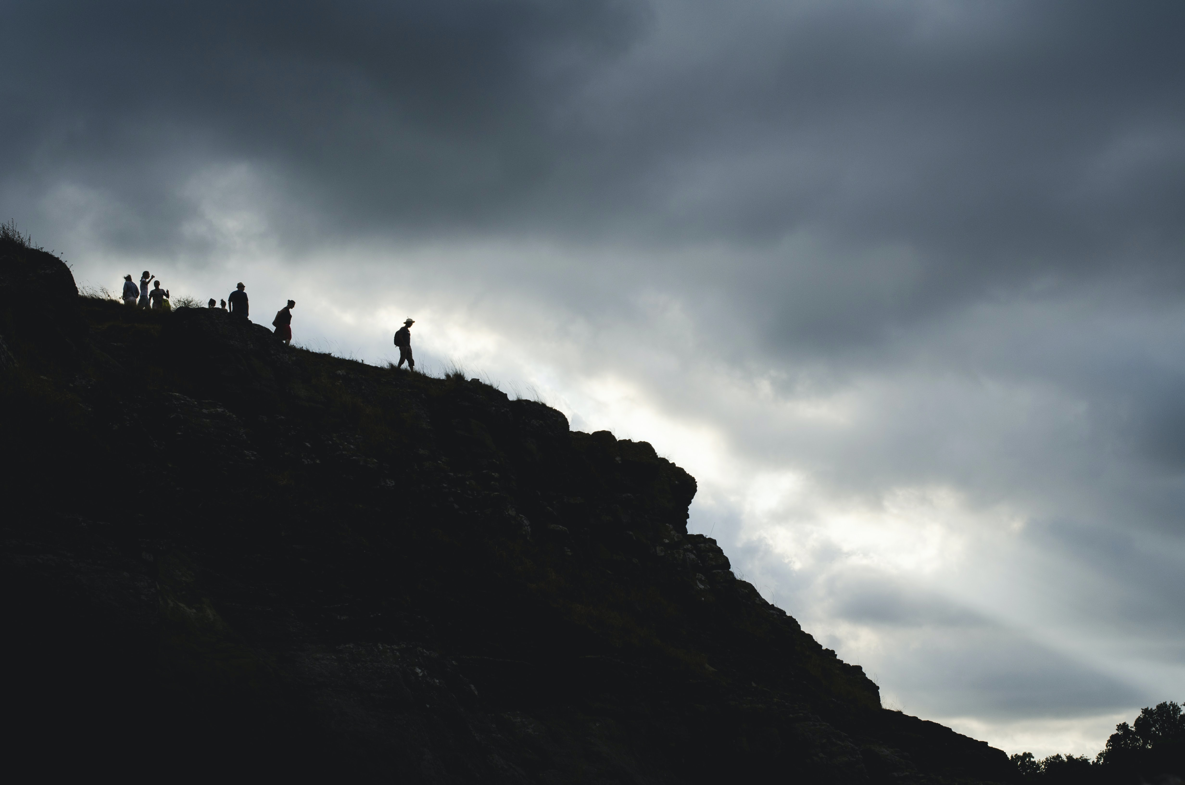 people at the top of a mountain during day