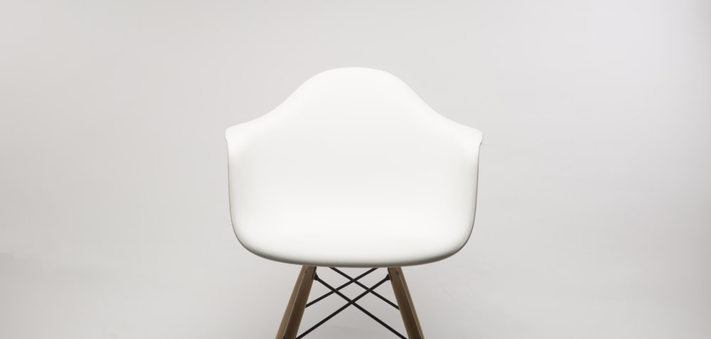 white wooden armchair