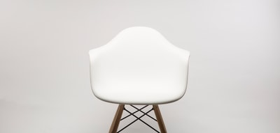 white wooden armchair chair zoom background