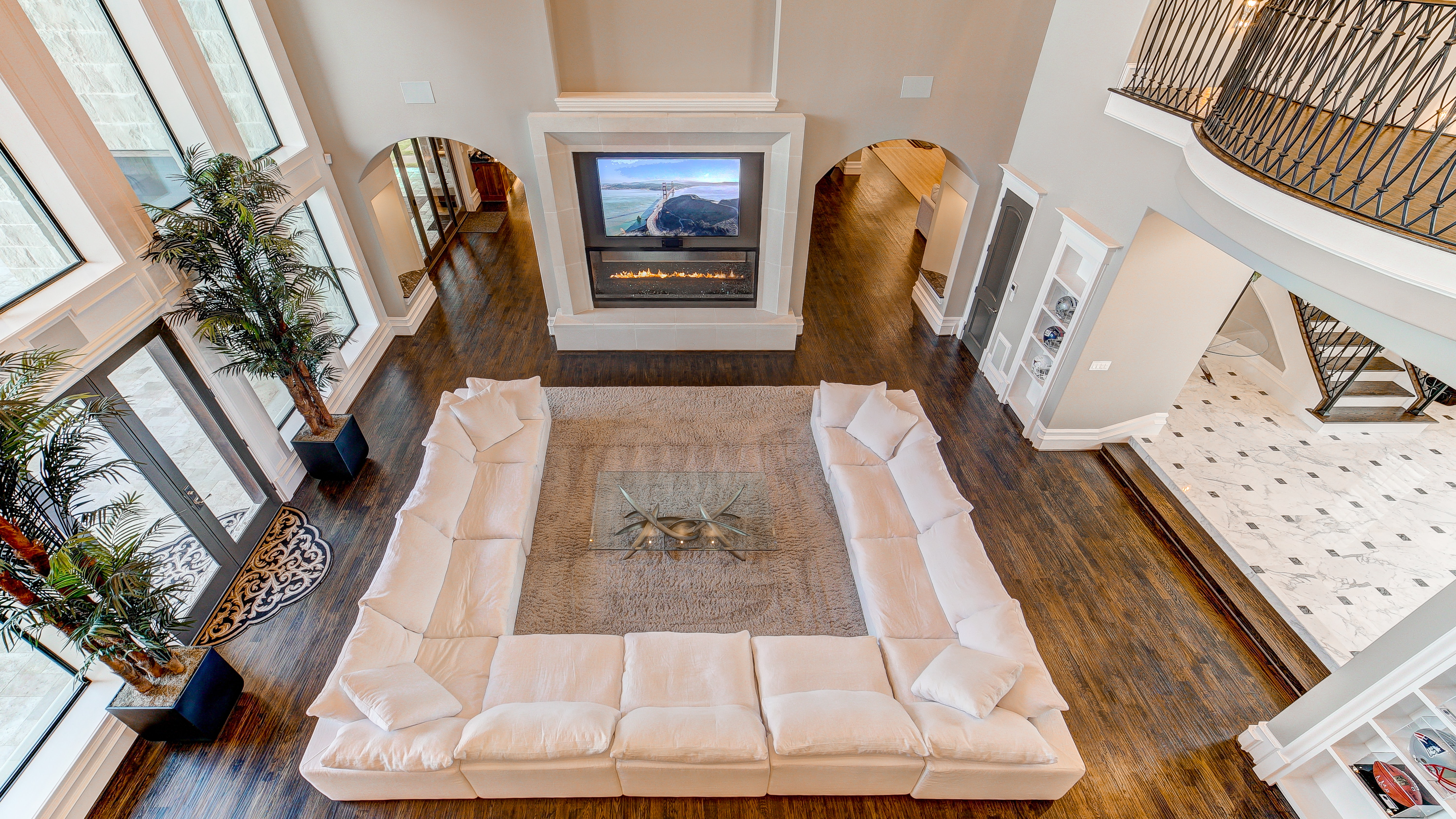 white sectional sofa in front of fireplace inside house
