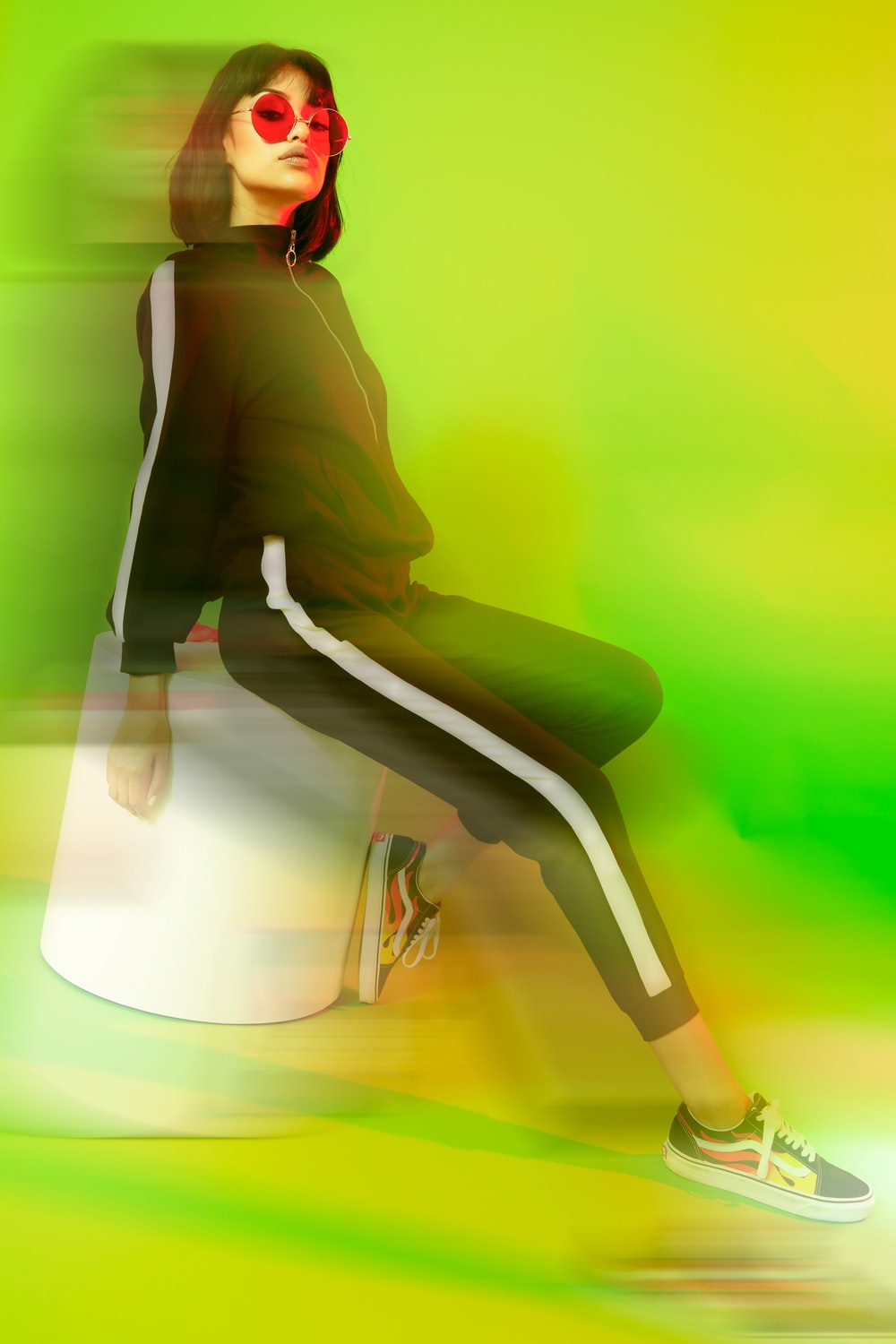 woman wearing white-and-black track suit