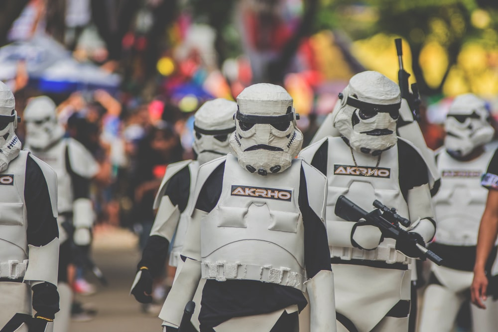 shallow focus photography of stormtrooper marching