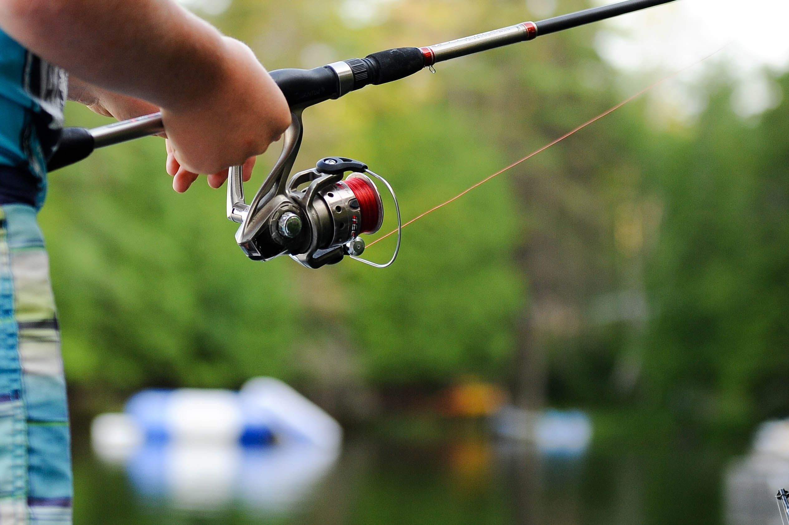 person holding fishing reel