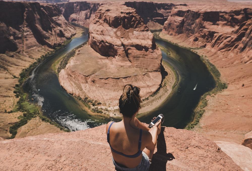 woman sitting in front of Horseshoe Bend, Arizona