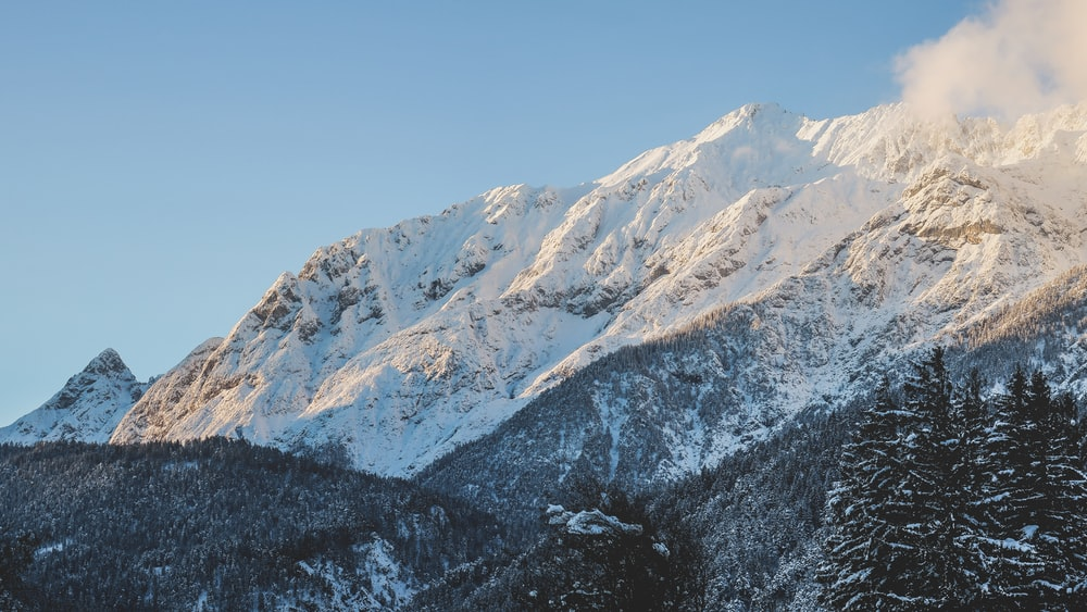 snow-capped mountain under clear sky