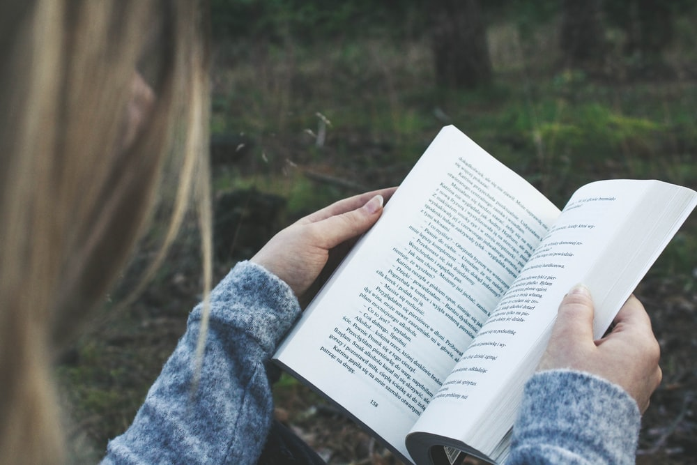 woman opening book