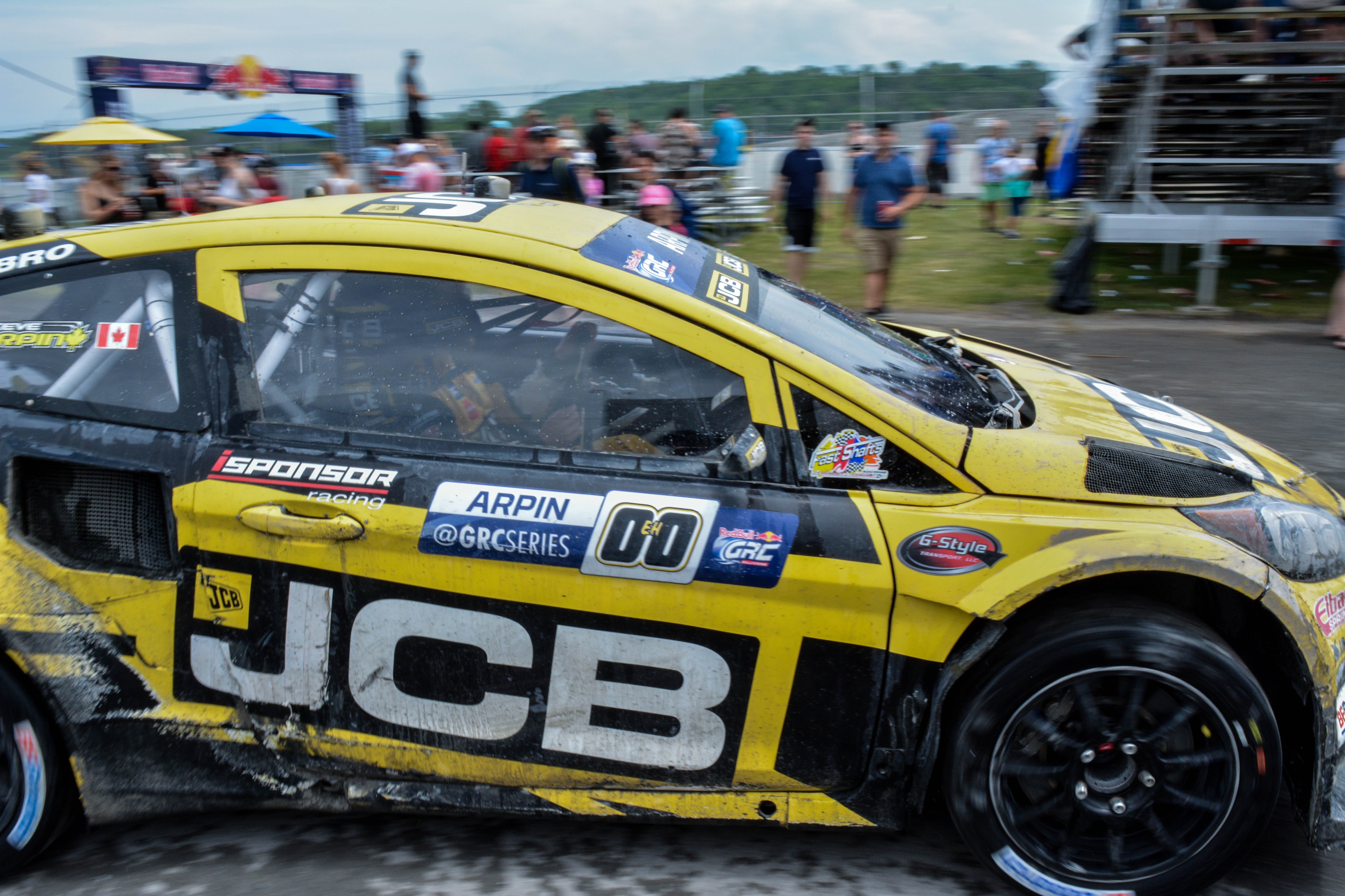 yellow, black, and white rally car