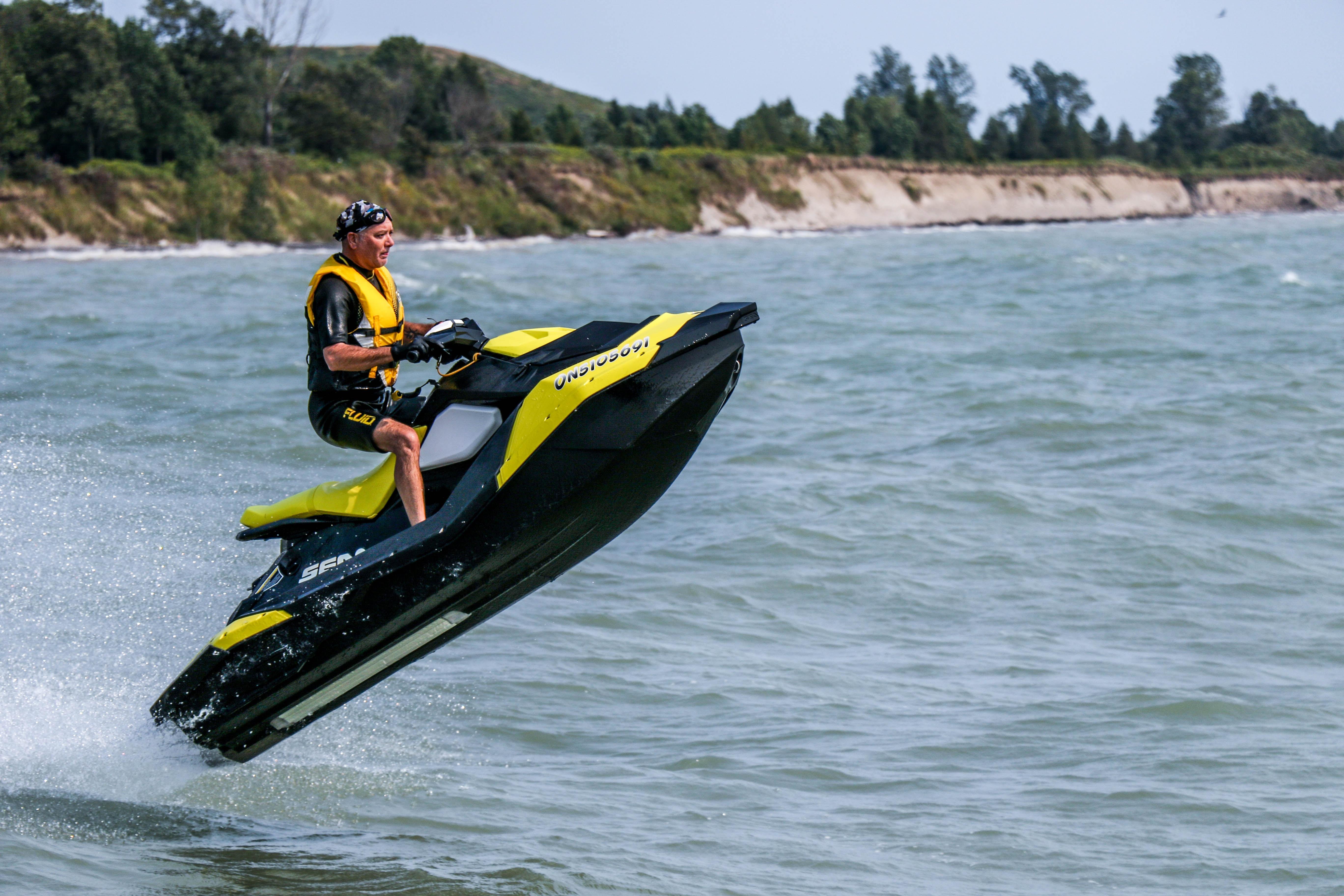 man riding personal watercraft
