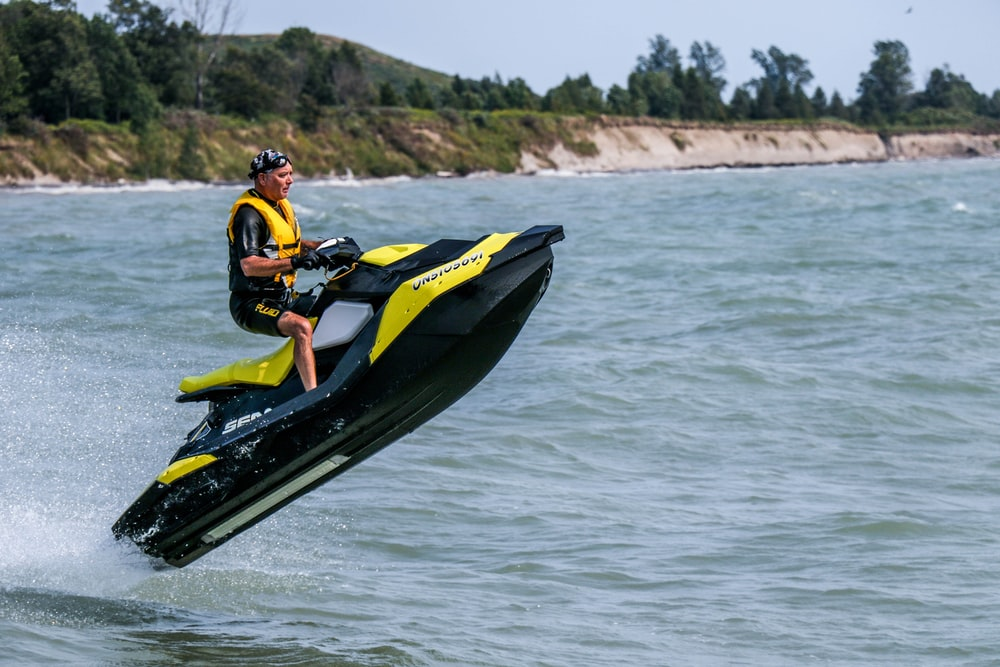 man riding personal watercraft