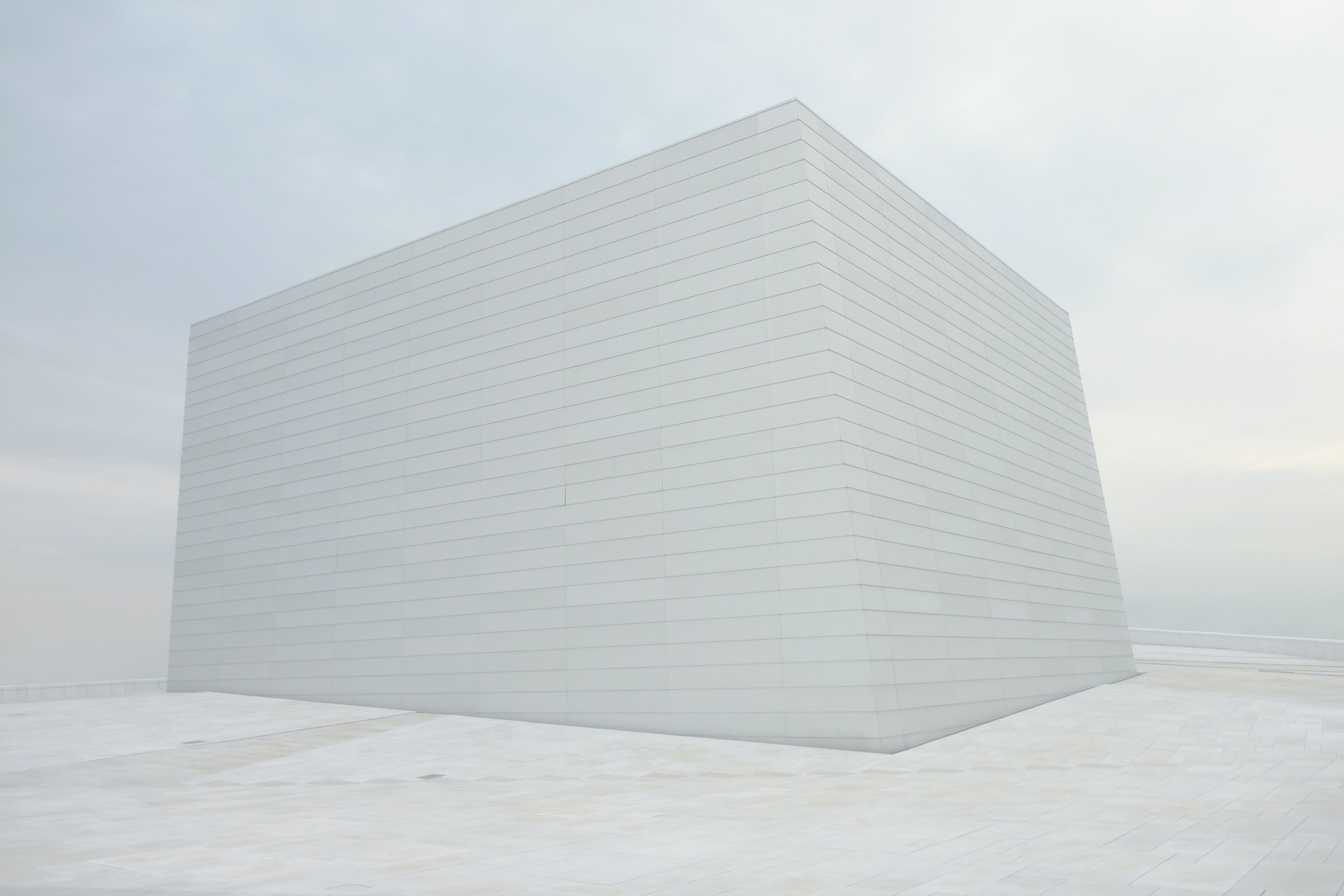 white building on snow field