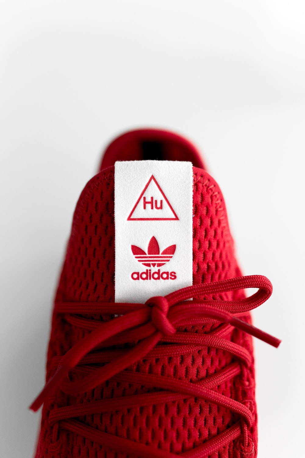 unpaired red adidas sneaker