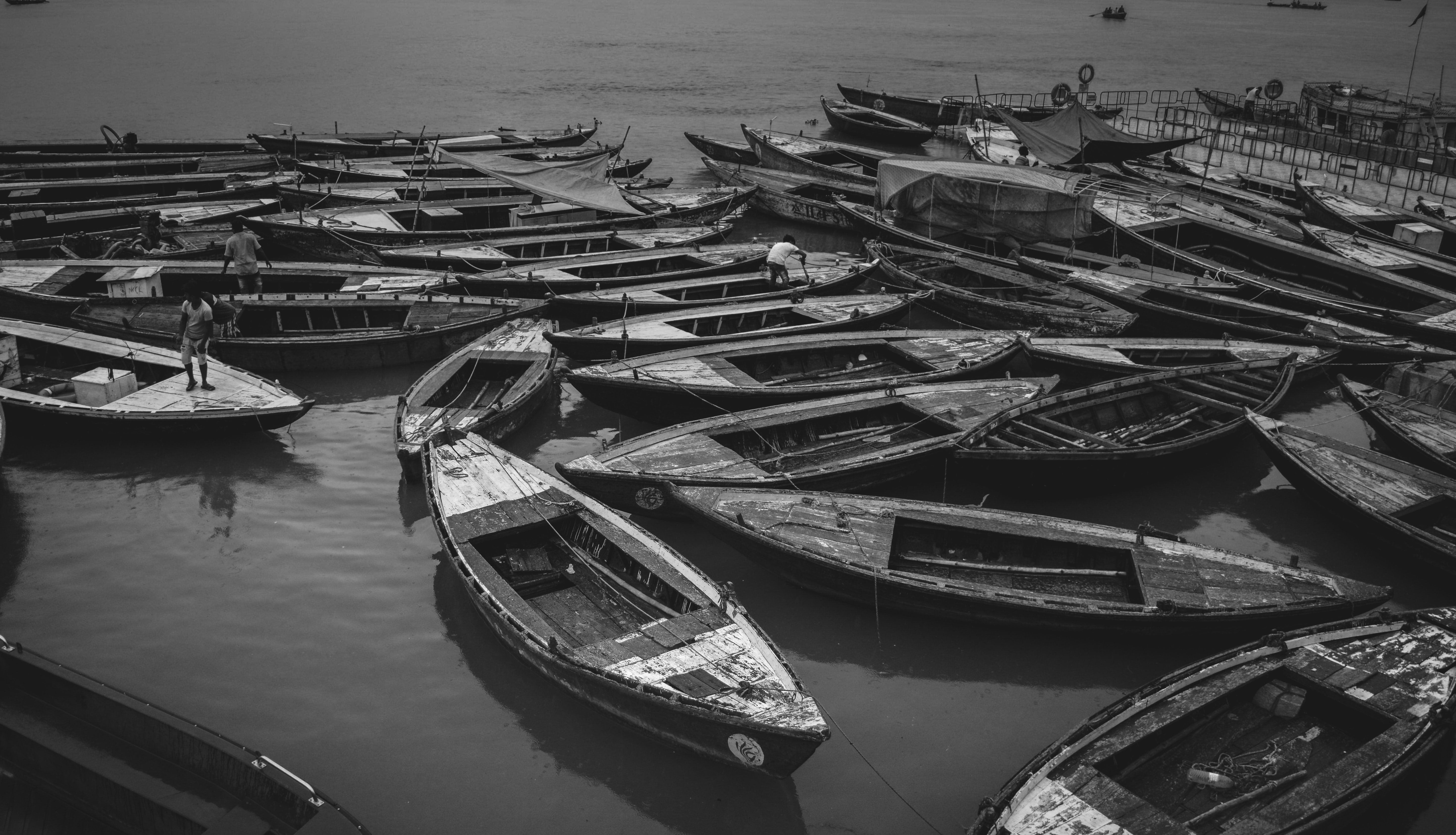 grayscale photo of boats on water