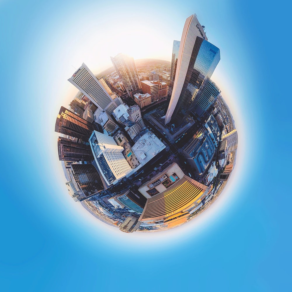 fish eye lens photography of high-rise buildings