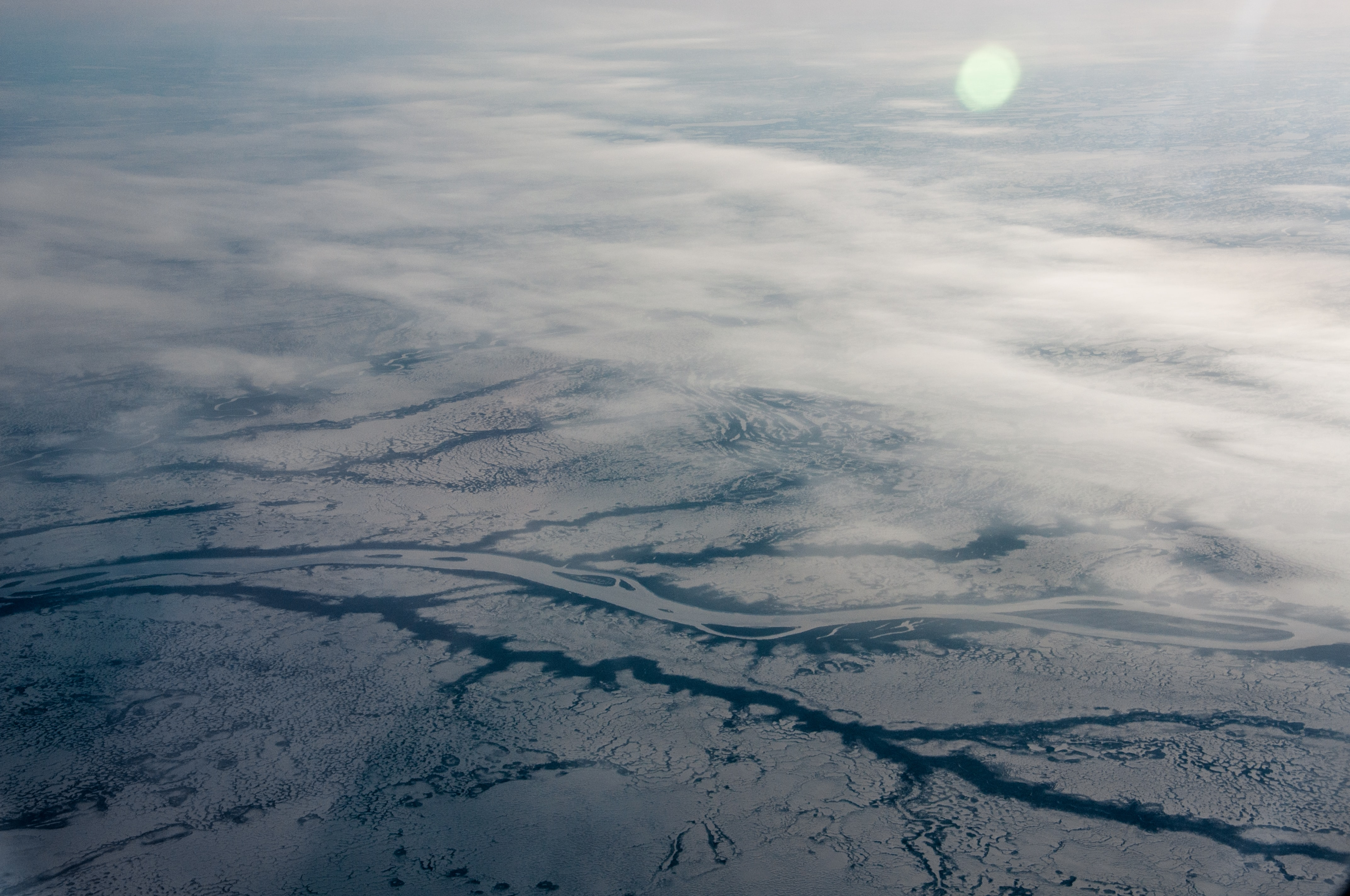 body of water covered by snow aerial view