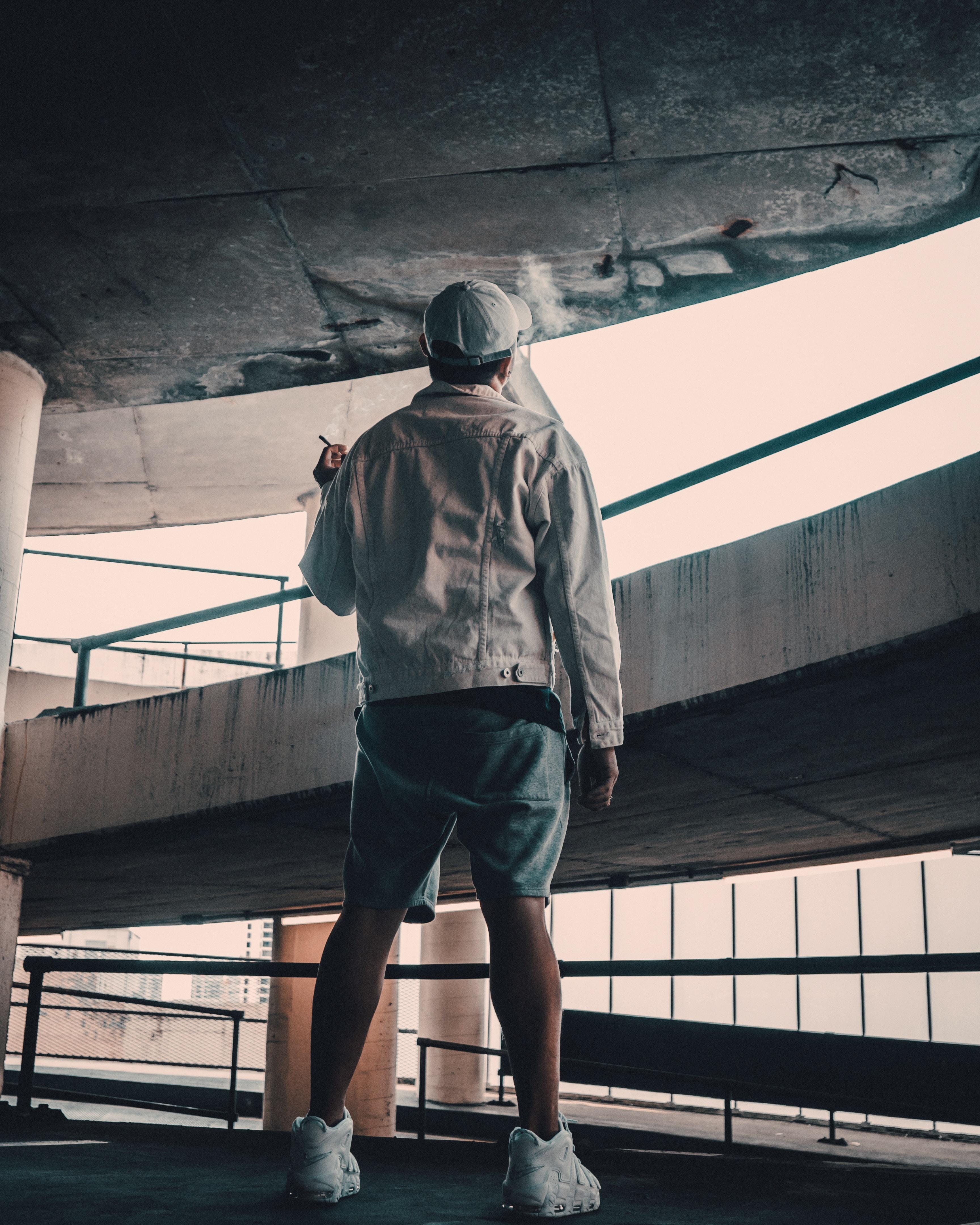 man standing in ramp way