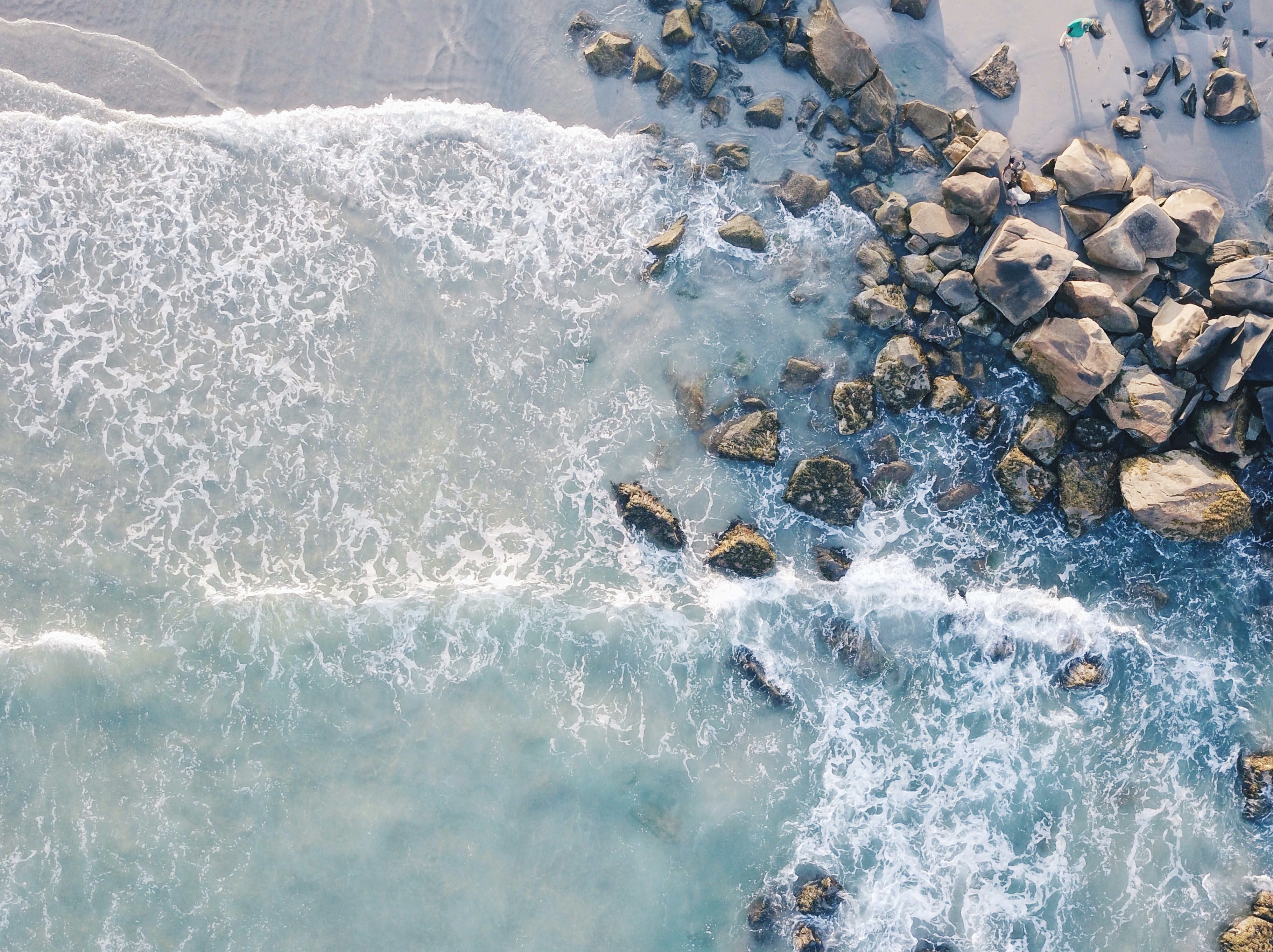 aerial photography of beach with stones