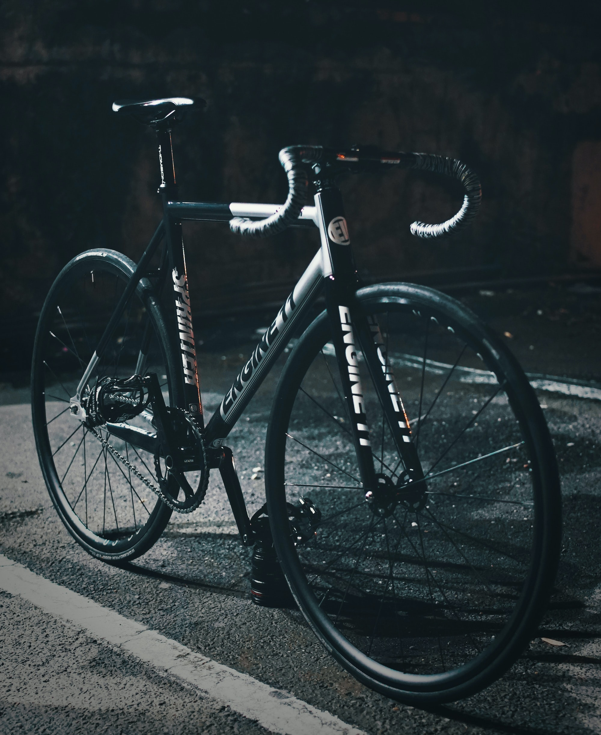 black and gray Engine 2 road bike at parking space outdoor