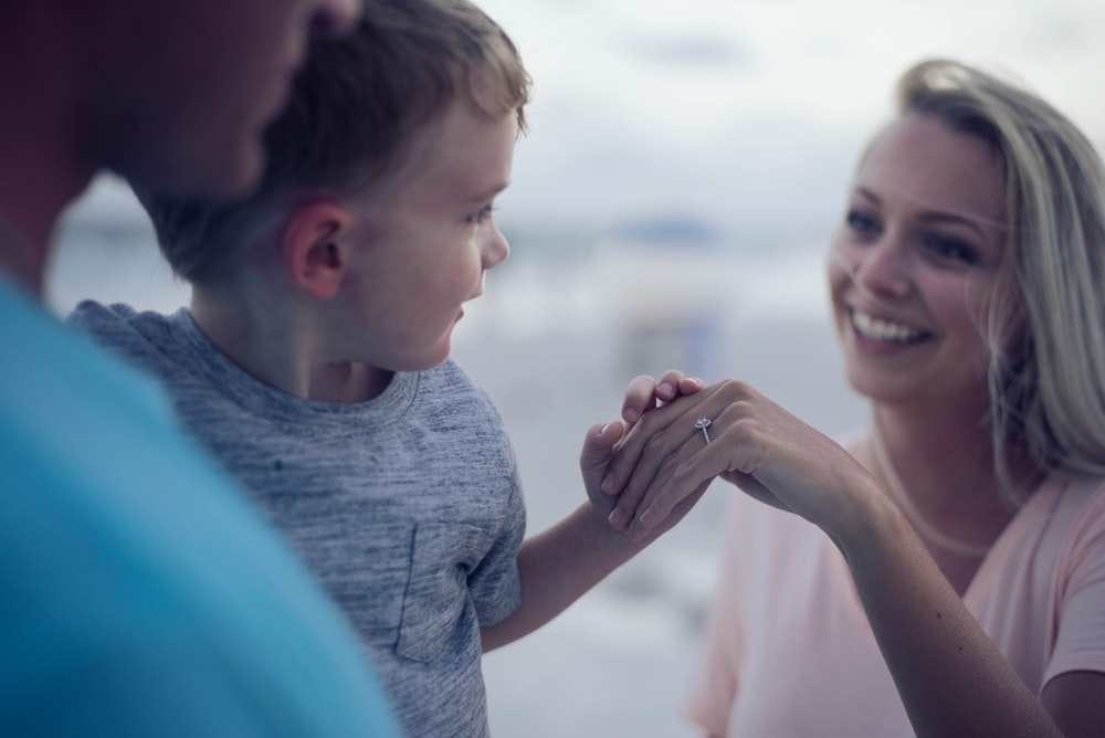 boy holding womans hand